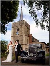 St Marys church Sawbridgeworth with wedding car in front