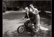 Bride and groom on a small B M X bike