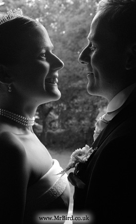 bride and bridegroom in church doorway smiling at each other