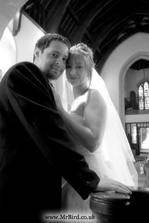 Portrait of bride and groom inside the church